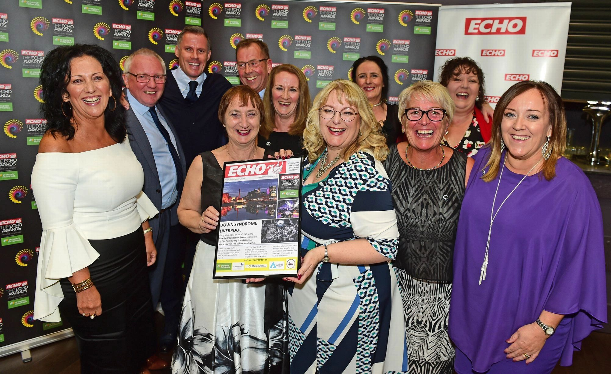 Downs Syndrome Liverpool trustees holding echo awards picture