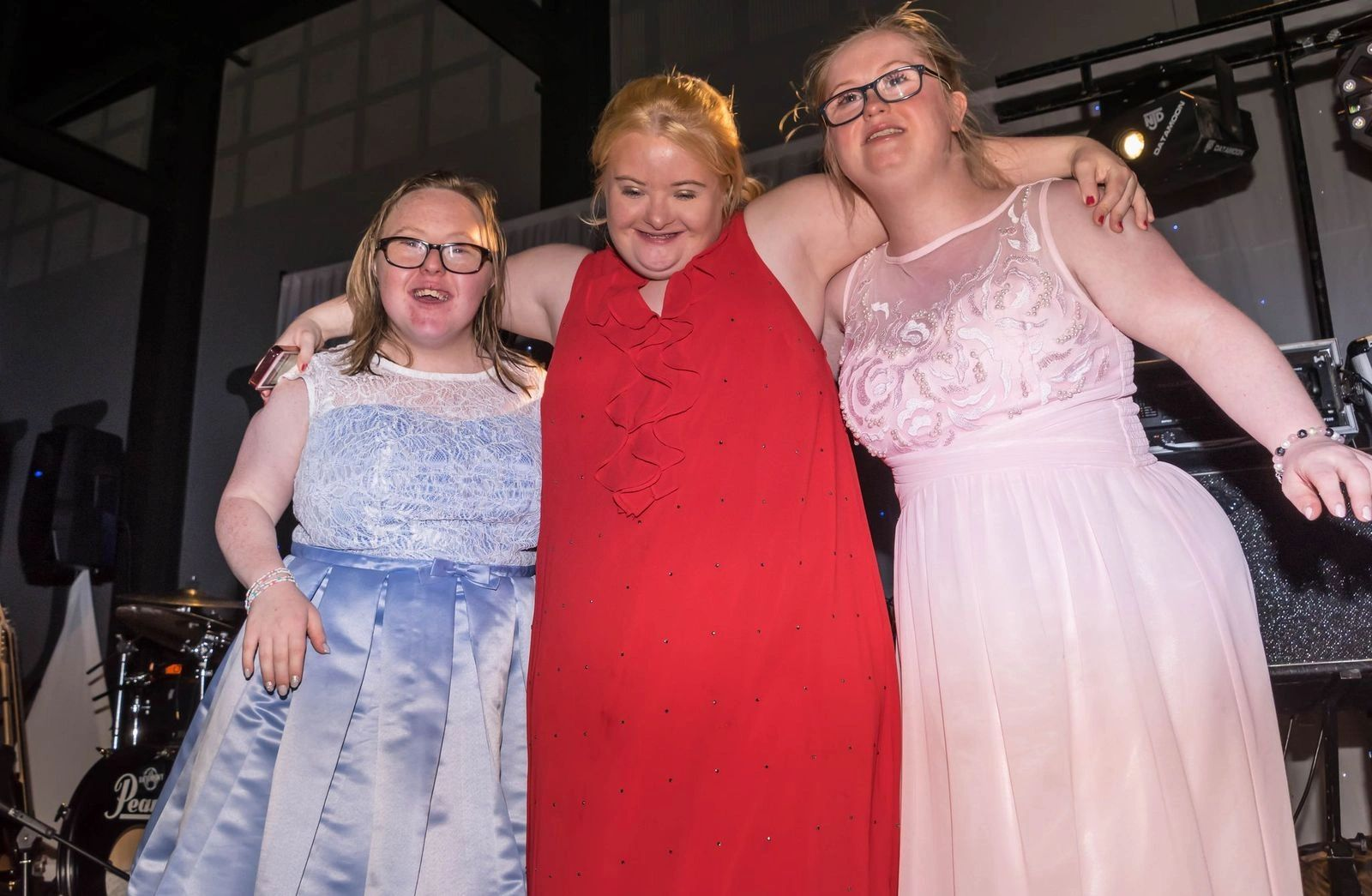 Three young women with Downs Syndrome smiling