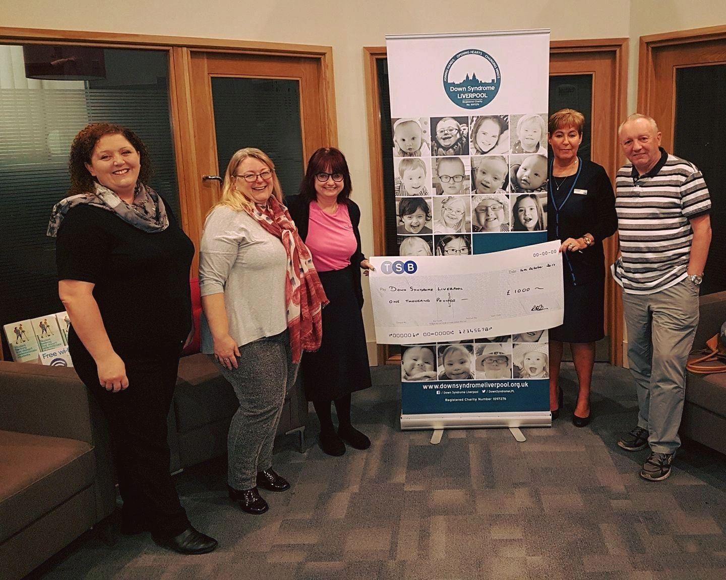 Downs Syndrome trustees being presented a cheque from TSB