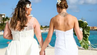 LGBT Wedding ceremony Couple in love walking down the aisle Beach wedding destination curacao
