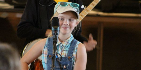 young fiddle player eager for Strawberry Jam Camp