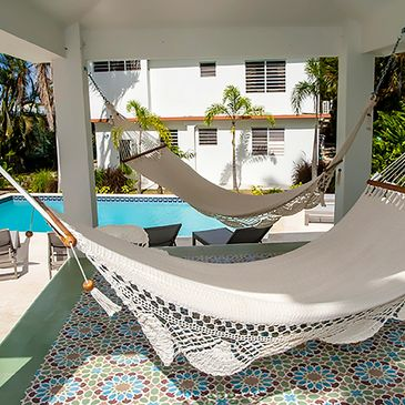 The apartment at R Casa with 2 bedrooms, 2 bathrooms and a shared pool and lounge area with hammocks