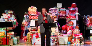 Stores and businesses can set up angel trees so employees and clients can donate gifts for children.