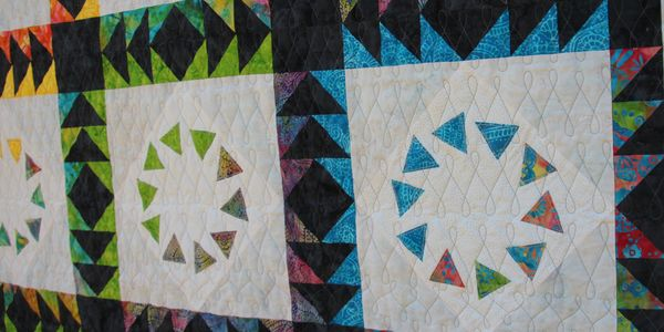 Sunburst Society by Lizard Creek Quilting. Fabric by Island Batik