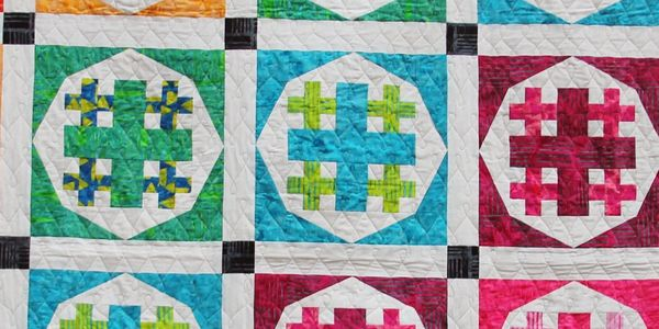 Infuse Joy quilt pattern by Lizard Creek Quilting. Fabric by Island Batik
