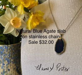 "Vibrant shade of blue. Rimmed with silver plate  bezel, Stainless  Steel,Hypo allergenic 19""Chain ."