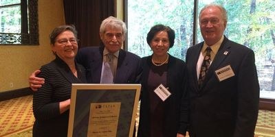 Myron Lasser (2nd from left) receives lifetime achievement award from NYS Trial Lawyers Assoc. 2018