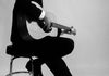 Gray Sartin - Johnny Cash Now - BW sitting on stool right profile