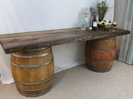 Mobile bar with live edge board and oak barrels