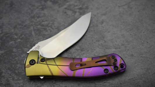 ZT0920 custom anodized with a gold purple fade and bronze drizzle.