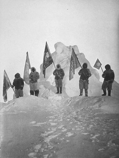 Robert Peary and sledge party with flags at North Pole. April 1909.