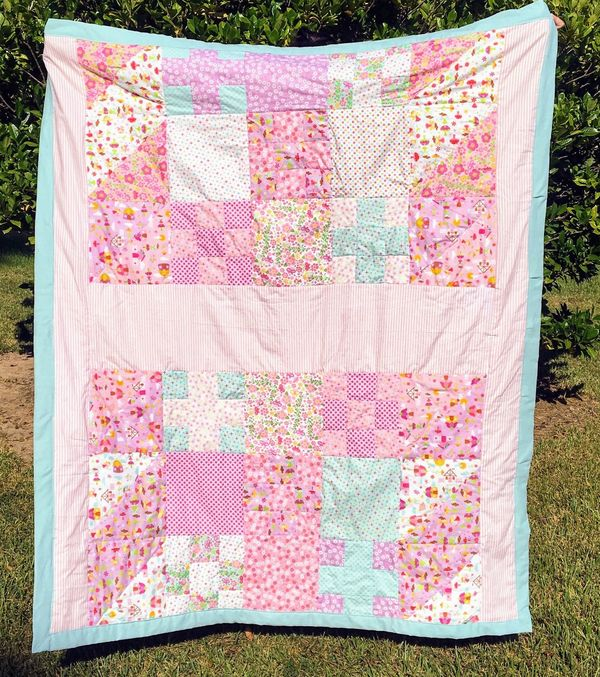 Beautiful handmade quilt with diagonal, full and nine patch squares. High quality cotton fablric in