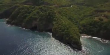 Dominica land for development. Beachfront, sea views, waterfall, river, utilities, road access.