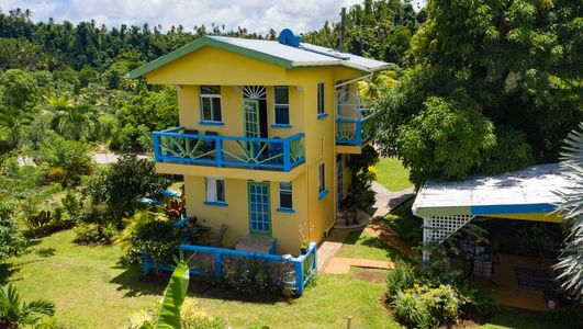 Dominica guesthouse.  Popular tourist village of Calibishie.  Near beach.  Turnkey property.