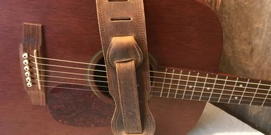 leather guitar straps and mandolin straps with leather picks and pick case