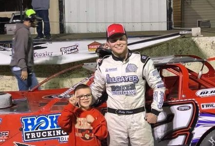 Picture of Dirt Track Driver Bobby Pierce and one of his favorite fans
