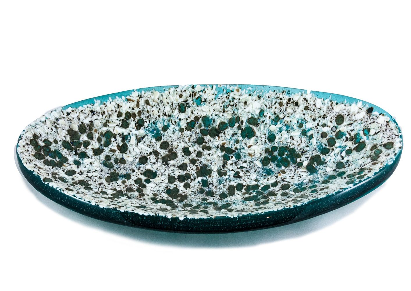 Fused layers of glass topped with reactive frit.   Beautiful teal and white.