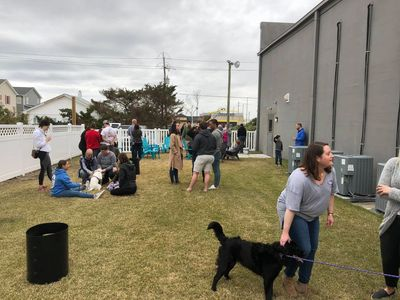 The grass backyard space that is dog friendly at the Crystal Coast Brewing taproom