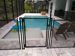 "42"" Pet Gate for Removable Pet Fence by Life Saver Pool Fence of Central Florida 407-365-2400"