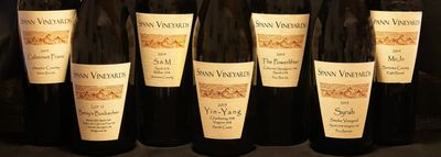 Photo of 7 different Spann Vineyards wine bottles