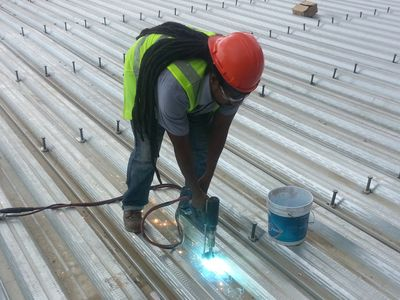 Arcon Electric Stud Welder in use.