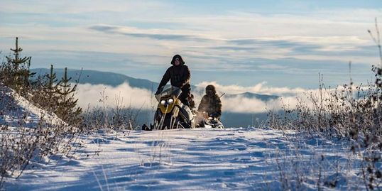 Snowmobile riding in winter wilderness adventure free and wild nature