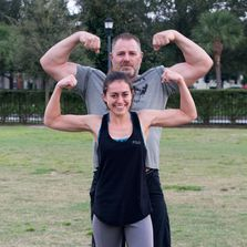 girl with big bicep muscles from krav maga