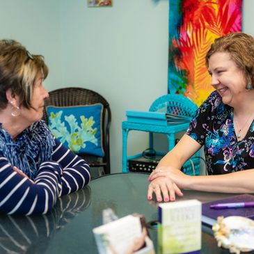 Lisa Green talks with one of her clients at Island Time Spa.