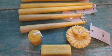 Tapers Voits beeswax bar 1 ounce Floating bee on a flower
