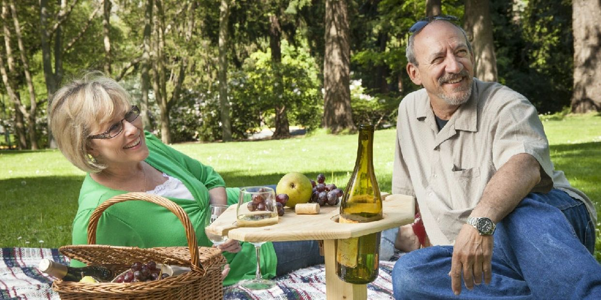 Picnicking in the park using my handmade portable wine table