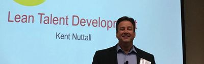 Kent Nuttall presenting the topic of Lean Talent Development at a conference.