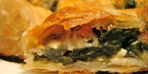 Flaky pastry stuffed with feta cheese and spinach.