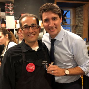 Sam Rawas, owner of Richard's Coffee house, standing next to Prime Minister Justin Trudeau.
