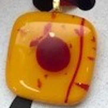 Fused glass pendants created with love by Cathy Peterson of Cedar Rapids for Cedar Moon Creations.