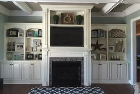 White mantle and built-in cabinets