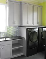 Laundry room with washer and dryer cabinets and utility sink