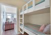 Bunks, with phone charging stations,. Pocket door darkens hallway/reduces sound.