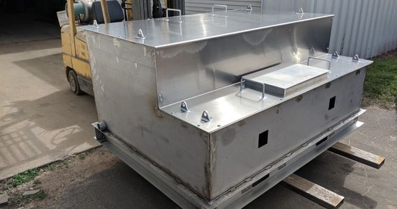 Stainless Steel tank on a skid with aluminum lid