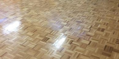 Commercial wood floor fitting and sanding St Asaph North.