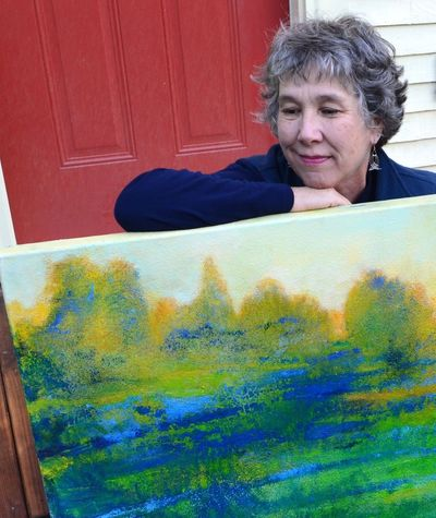 Artist with a large landscape, oil and sand.