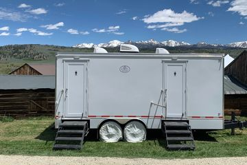 6 stall royal executive restroom trailer a private ranch wedding in Pinedale Wyoming