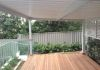 Metal awning, timber deck, aluminium louvres in Colorbond Surfmist