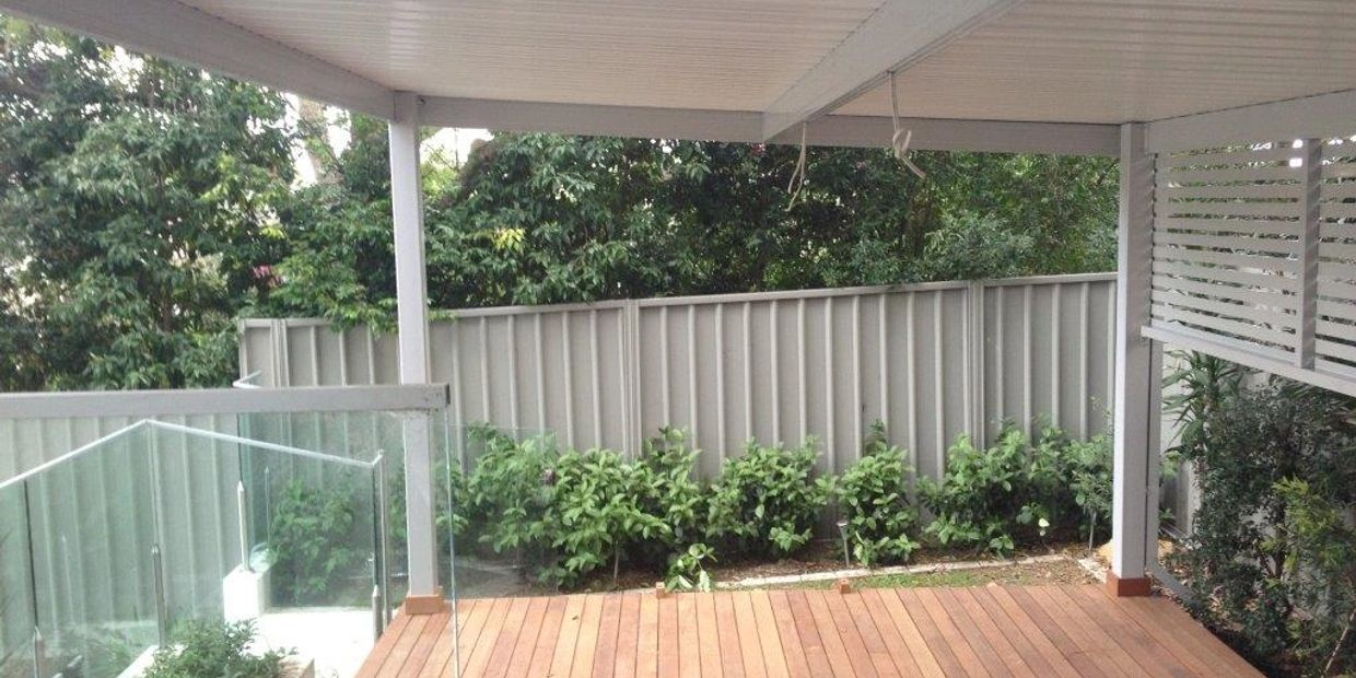 Outdoor timber deck with Colorbond metal awning and louvred privacy sceen