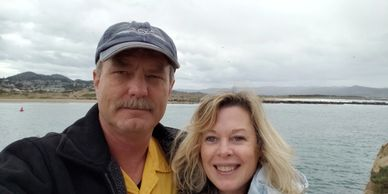 Dean and Debi from Fiesta in r Siesta RV taking a photo at Morro Bay