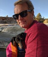 Dean keeping Jimmy warm after taking a dip in the Travertine Hot Springs. Photo by FiestainrSiestaRV