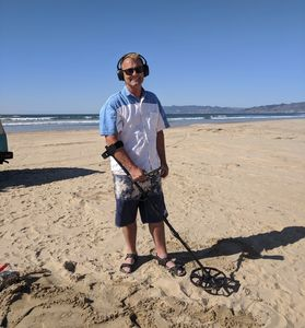 Dean at Pismo State Beach using the detector he purchased from Sunny Mountain Prospecting