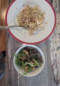 Raisin and Walnut salad with vinaigrette dressing and Fettuccine with Alfredo sauce. Photo by Debi.