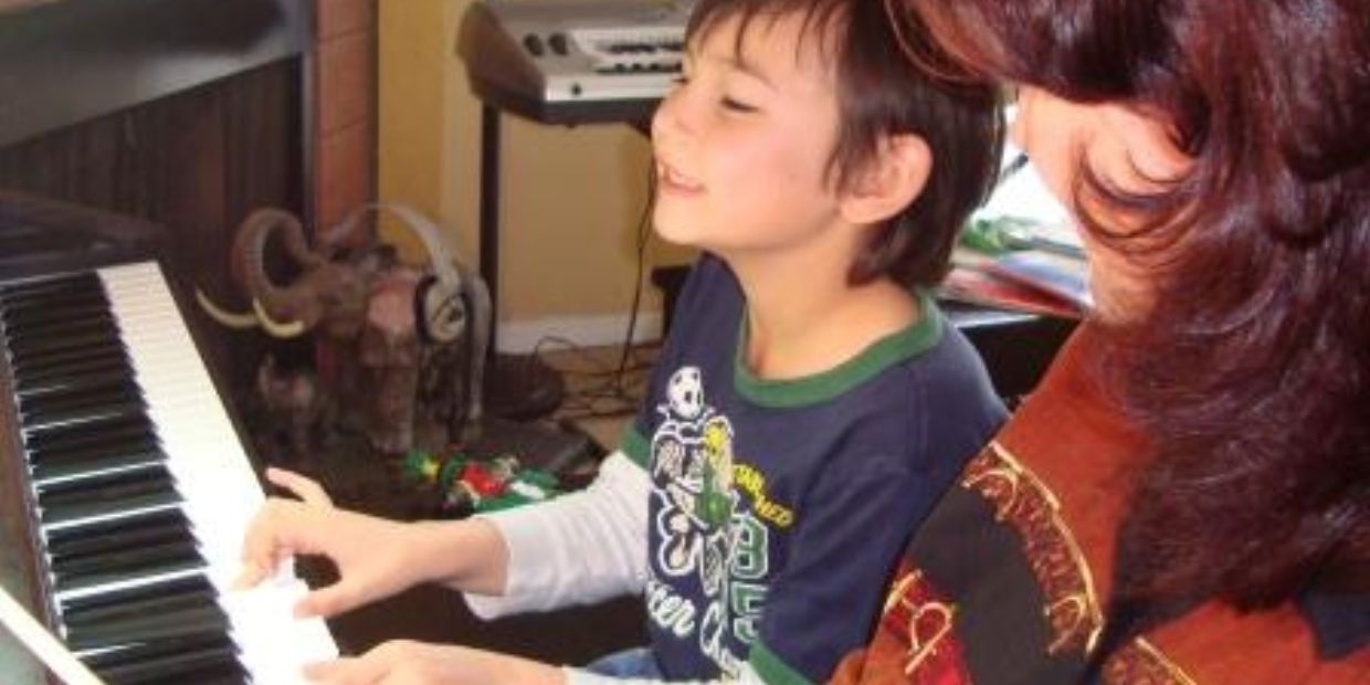 He learns how to play piano at preschool piano lessons in Happy Valley, OR