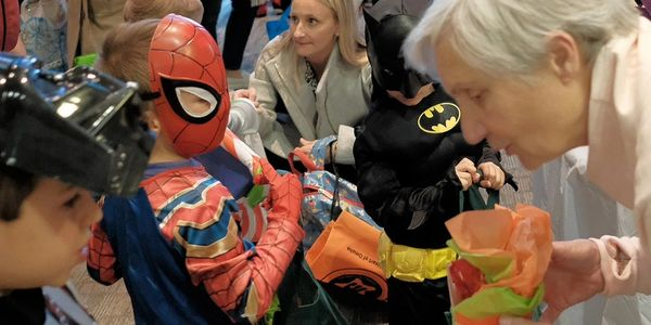 Passing out candy to small Darth Vadar, Batman and Spiderman
