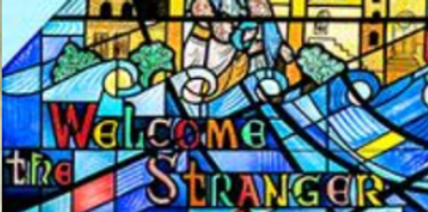 "Stained-glass image with the words, ""Welcome the Stranger"""